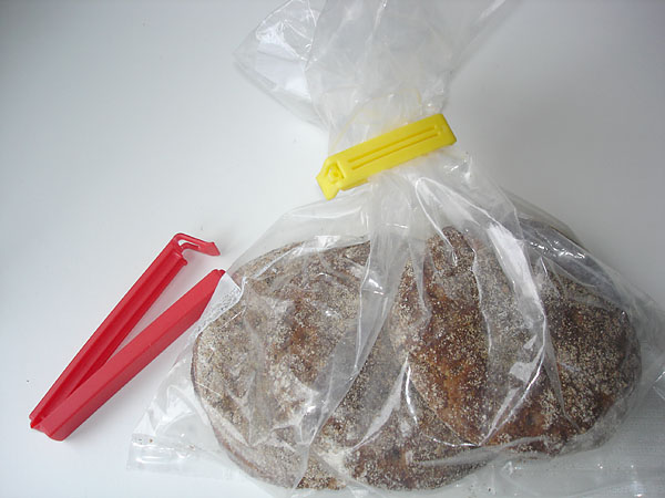 Plastic bag sealed with a plastic clamp
