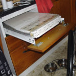 Kitchen drawer with built-in ironing board