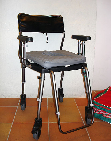 Folding shower chair on wheels