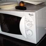 Microwave oven with easy-grip handle