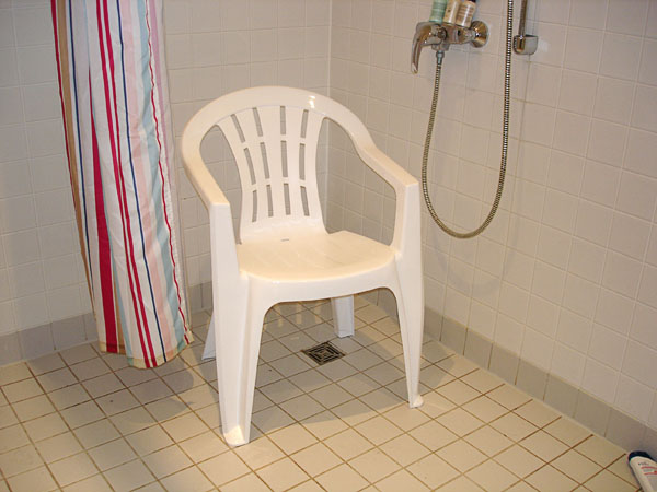 Plastic lawn chair works as shower chair when traveling