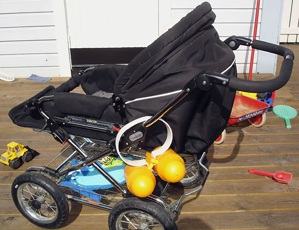 Combi stroller with soft fabric carrier