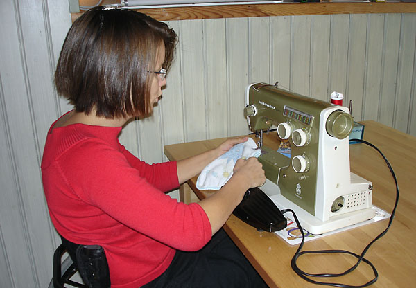 Controlling sewing machine with arms