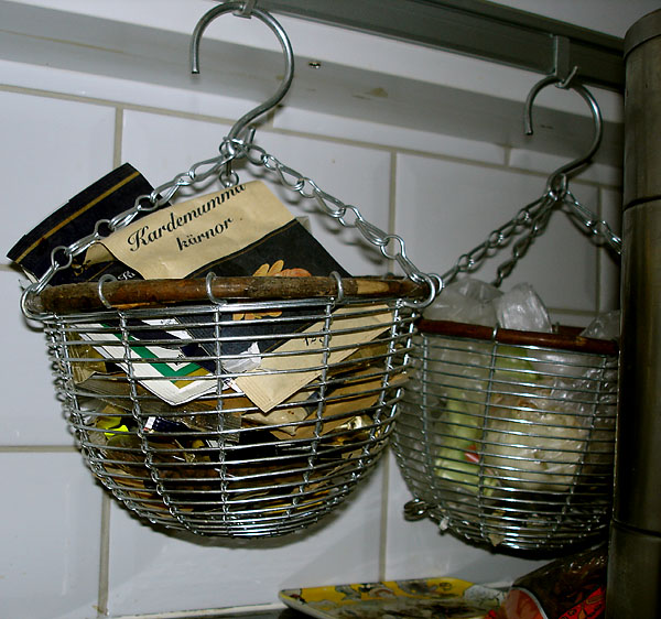 Storage baskets hanging from the bracket