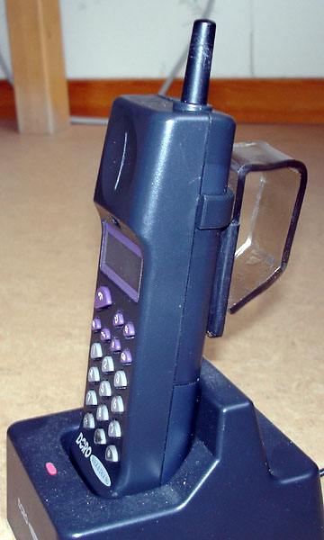 Portable telephone with homemade handle