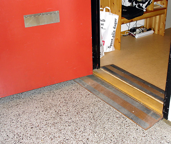 Threshold ramp at apartment door