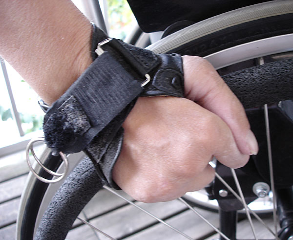 User with wheelchair gloves