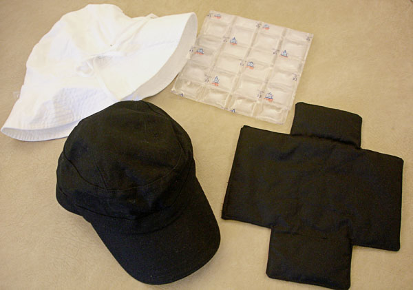 Cap and sun hat with built-in cooling or heating pads