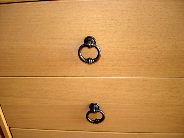 Ring-shaped handle on drawers (close-up)