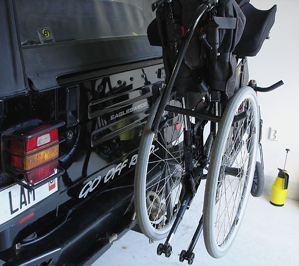 Bicycle holder for manual wheelchair