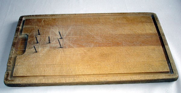 Cutting board with nails