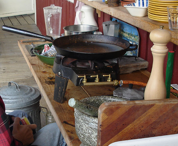 Cast-iron frying pan on LPG stove