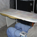 Wall-mounted folding ironing board