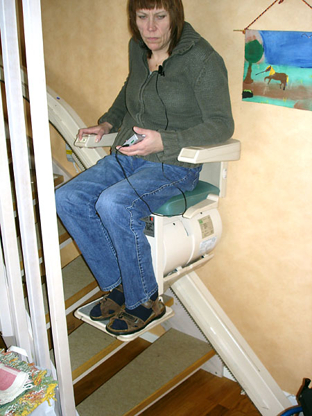 User on chair stairlift