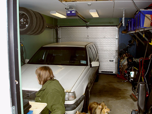 Garage with car and shelves on the wall