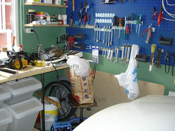 Shop in garage with recycling bins