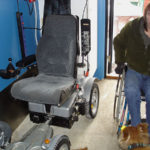 Storage place for electric wheelchair