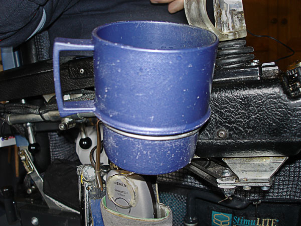 Mug and mug holder on electric wheelchair