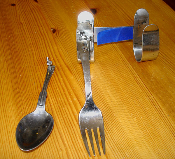 Orthosis with fork and spoon