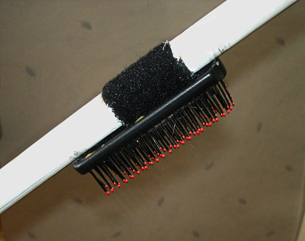 "Hair brush on ""cough rod"" (close-up)"