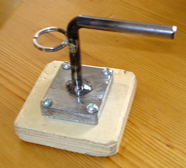 Wooden board on holder with key ring