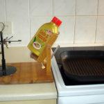 Cooking, tilting holder for oil/butter