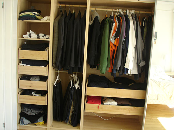 Closet with open doors –  drawers and closet rod