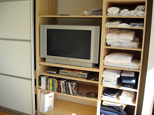 Closet with open doors – shelf with TV