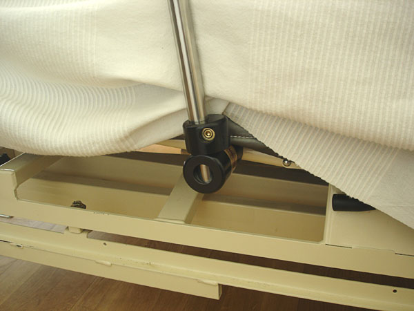 Attachment of stand to bed frame