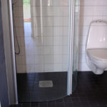 Guest bathroom with accessible shower stall