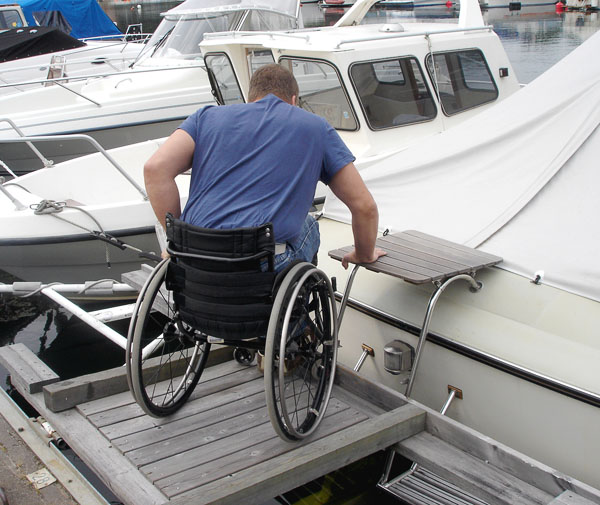 User transfers from dock to platform on boat's swimming ladder