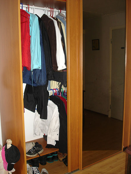 Closet with sliding doors and closet rods