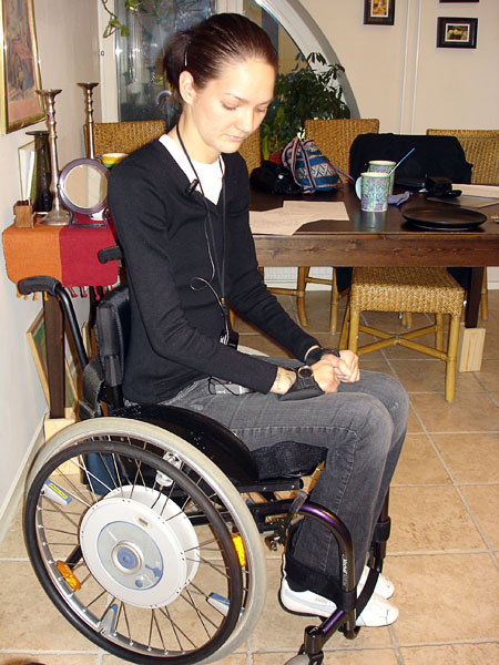 User in Küschall chair equipped with e-motion wheels