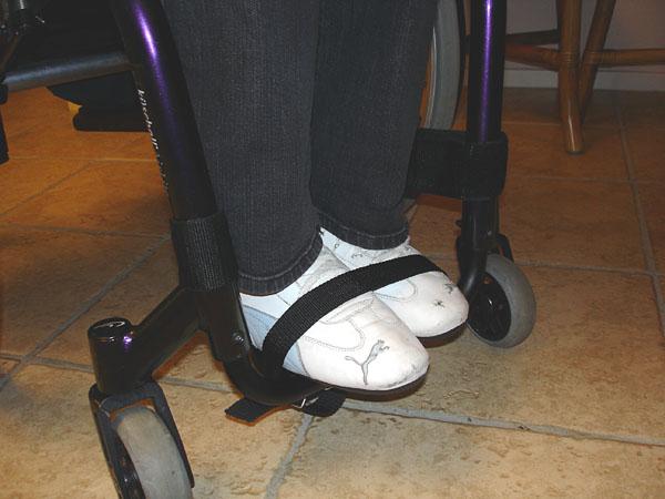Securing feet to wheelchair foot bar