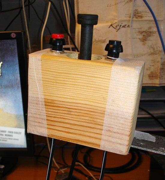 The joystick and 2 contacts embedded in wood block