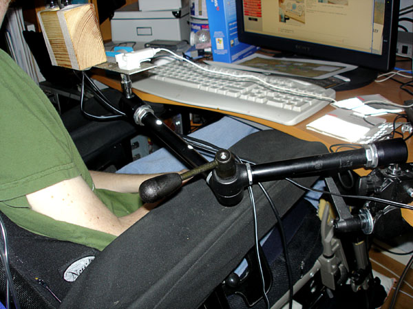 Camera tripod as joystick holder for controlling computer