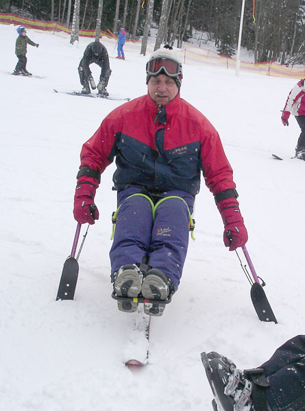 User brakes on hill with hinged ski poles