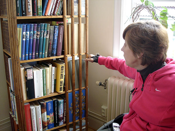 User rotates bookcase (close-up)