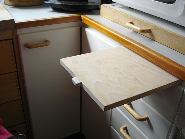 Pull-out board with custom handle