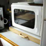 Microwave oven on sliding board