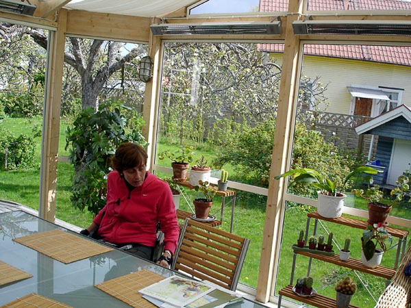 User in enclosed patio with infrared heating