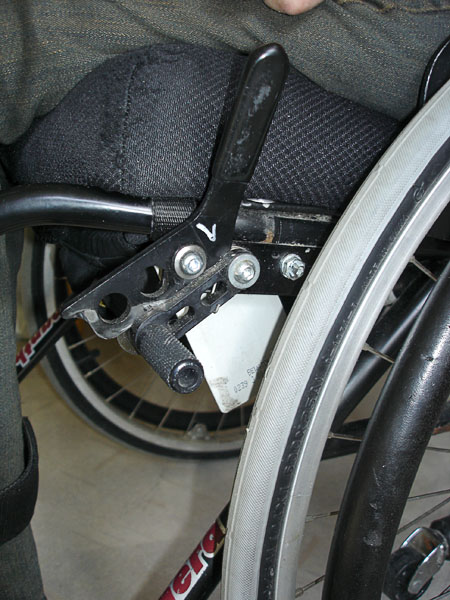 Door key card, attached to wheelchair frame