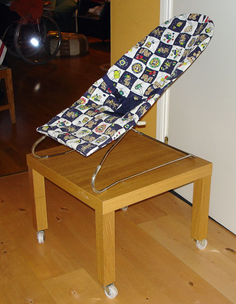 Babysitter chair on table