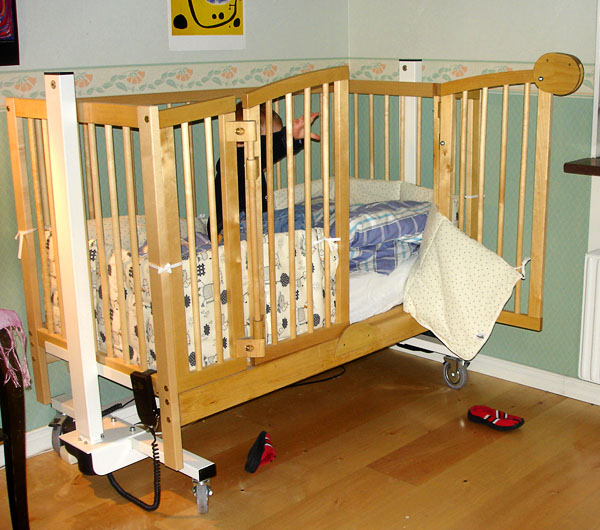 Crib, adjustable height power-operated