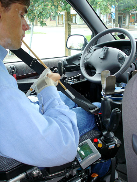 User sitting at the wheel