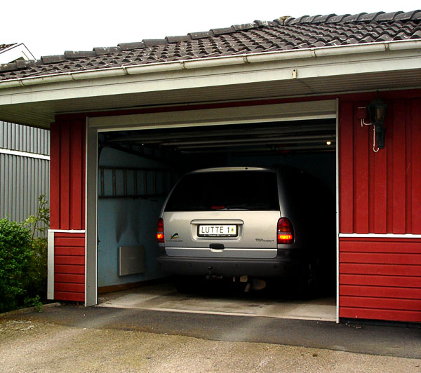 Car in garage with open garage door