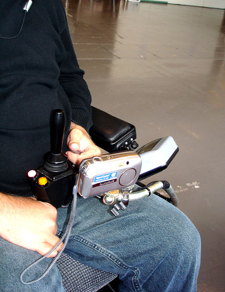Camera attached with stand/holder on electric wheelchair