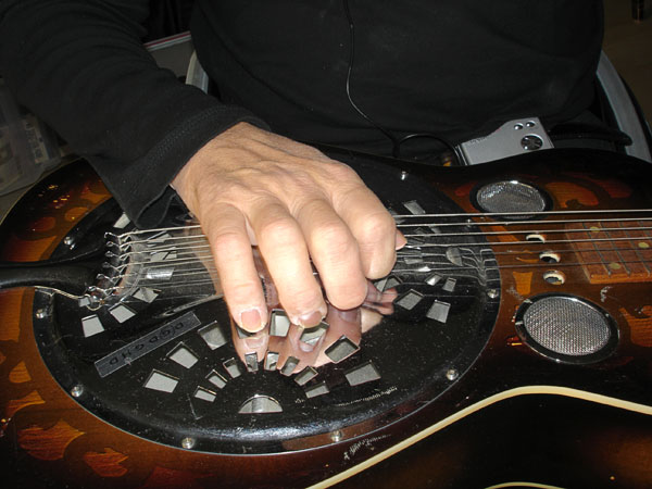 User plays slide guitar