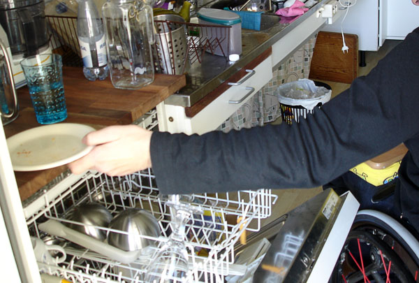 User at dishwasher