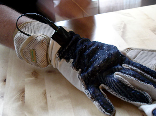 User with heated gloves and battery pack on